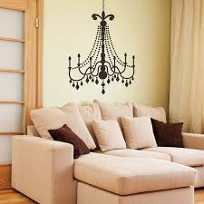 large black glamour chandelier on a light tan wall