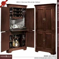 bar corner furniture. this handsome corner wine and bar cabinet features four raised panel doors with antique brass furniture