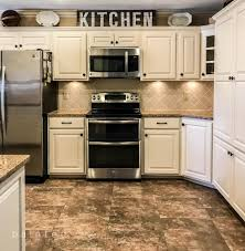 sherwin williams aria ivory updates these oak cabinets