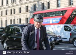 Parliament Square, London, UK. 10th Oct, 2018. Boris Johnson on his bicycle  in Parliament Square. Penelope Barritt/Alamy Live News Stock Photo - Alamy