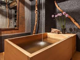 like a simpler version of a hot tub a wooden bathtub particularly a round one is meant for soaking and for hot water