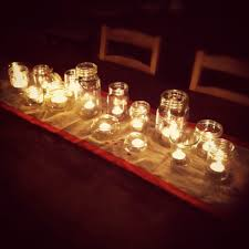 Decorating Jelly Jars From the kitchen a simple centerpiece of tea lights in jam jars 43
