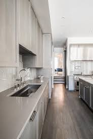 taupe quartz countertop modern beautiful off white kitchen boasts an island accented with throughout 3 andreapinti com