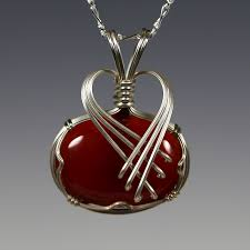 criss cross sterling silver wire wrapped carnelian pendant