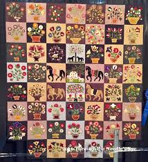 My Emily Munroe Quilt, by Susan Calhoun and quilted by Terry ... & 7 fantastic Facts about Folk Art Quilts with examples from the  International Quilt Festival Chicago Adamdwight.com