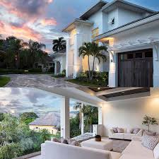 architectural designs for homes. two views at dusk, including one from the back balcony. architectural designs house plan for homes