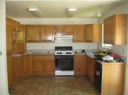 Wall Paint For Kitchen White Wall Paint With Brown Wooden Oak Cabinet On Ceramics Also