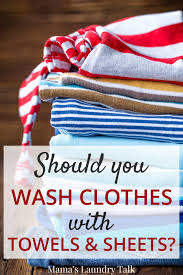 you wash clothes with towels and sheets