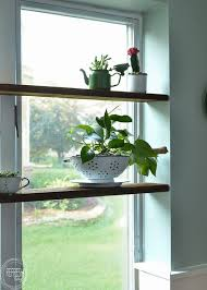 diy floating shelves in windowsill with succulent garden in vintage enamelware 1 of 8