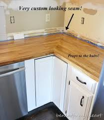 in the below you can see how cy made the rounded corners in the wood around the sink we applied a bead of caulk between the wood and the sink to