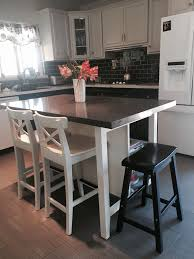 ikea stenstorp kitchen island hack here is another view of our ikea island we added grey quartz on top with more room to add a saddle bar stool
