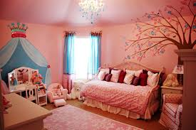 Pink Wall Paint Has Murals And Chandelier In Ceiling Design Also Wooden  Flooring In Kids Bedroom ...