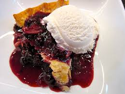 blueberry pie with ice cream. Delighful With Slice Of Warm Blueberry Pie With Vanilla Ice Cream Inside With B