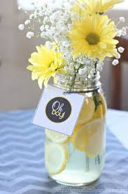 blue mums and masons jars and use mason jars for drinks Gray & Yellow Baby  Shower Decorating Ideas. Easy centerpieces with lemon slices, baby's  breath, ...