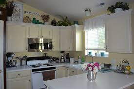 Decorating Above Kitchen Cabinets Ideas For Decorating Above Kitchen Cabinets Black Stove Dark