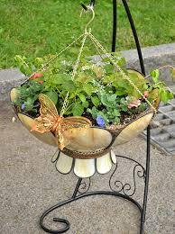 Lampshade planter - Looking at objects in a different way in this case  upside down can help you create unusual container gardens.