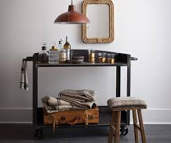 Made with industrial iron with a distressed finish, this is a rough and  tough bar cart that would look amazing in any room, provided it's not ...