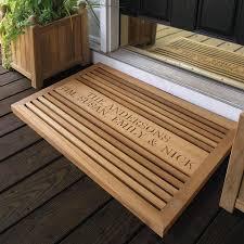 Grande teak doormat with personalized engraving.