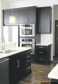 Dark Espresso Kitchen Cabinets Dark Expresso Cabinets Topped With White Quartz Countertops Create