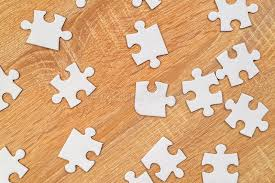 white jigsaw puzzle pieces tered on wooden table stock image image of unsolved