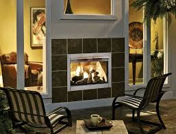 two sided indoor and outdoor fireplace installation with clear glass cover for great view of burning fire