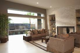 modern look living room. modern look living room features expansive glass wall to outside fountain, along with unique wood o