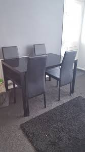 blk gl table and 4 chairs jpg