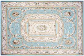 cream and blue aubusson rug with al instruments and accents of gold pink rose