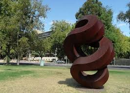 spiral large rusted iron sculpture