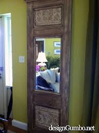 an upscale french style trumeau mirror made from an old door