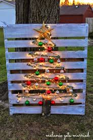 this diy tree is made by putting nails on a pallet and stringing lights and