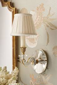 beautiful wall decor with mirror brass and crystal sconce and white lilacs wall lighting