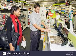 office merchandise. Miami Florida Staples Office Supply Products Store Retail Business Chain Merchandise Display Laptop Computer Hispanic Black Man
