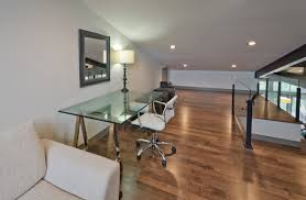 open space home office. open plan modern home office in upstairs mezzanine space featuring glass topped trestle table f