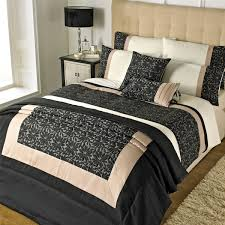 bed cover sets. Riva Home Elise Floral Petal Duvet Cover Set, Black/Gold, Single - Linens Limited Bed Sets