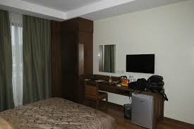 bedroom with tv and desk. Mansion Garden Hotel: Room Cabinet, TV, Desk And Mini-ref Bedroom With Tv