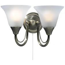 boston 2 light switched wall fitting in antique brass finish