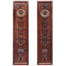 pair of carved art deco motif decorated hanging mahogany wall panels for