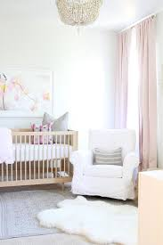 white and pink nursery with pink french pleat ds