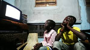 black kids watching tv. study says tv is damaging black boys and their self esteem kids watching tv