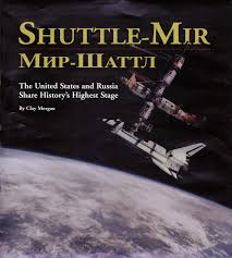 「On June 29, 1995, the American space shuttle Atlantis docks at the Russian space station Mir to form the largest man-made satellite ever to circle the Earth.」の画像検索結果