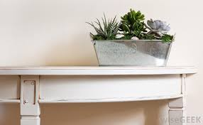 A console table is a table that either sits up against a wall or is  attached to a wall.