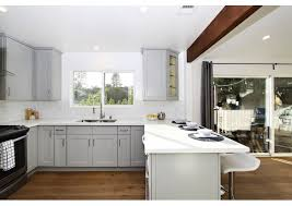 white countertop with grey cabinets