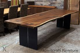 live edge chicago area walnut dining table with steel legs features book matched black