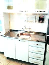 kitchen island with seating faucets menards sink clogged kitchens 5 vintage cabinets by metal boomerang wonderful