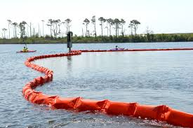 u s department of defense photo essay kayakers at naval air station pensacola detour around oil containment boom on base at sherman cove