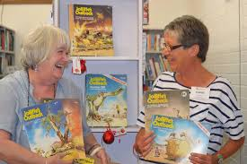 save the children book volunteers pauline webb and claire curran with a collection of jolliffe memorabilia