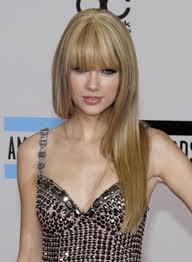 taylor swift long straight blonde hairstyle with bangs