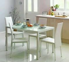 white glass dining table 4 chairs argos warranty