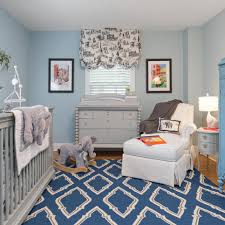 Light blue walls are a classic touch to this baby boys nursery A